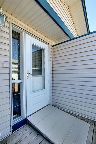 Photo 2: 22 33 Stonegate Drive NW: Airdrie Row/Townhouse for sale : MLS®# A1094677
