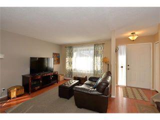 Photo 4: 10 GLENPATRICK Crescent: Cochrane House for sale : MLS®# C4094257