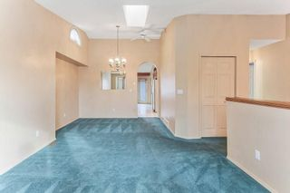 Photo 7: 51 SANDRINGHAM Way NW in Calgary: Sandstone Valley House for sale