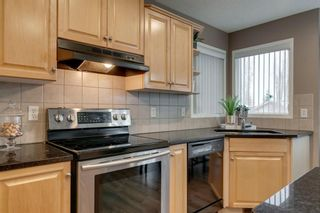 Photo 7: 100 Covehaven Gardens NE in Calgary: Coventry Hills Detached for sale : MLS®# A1048161