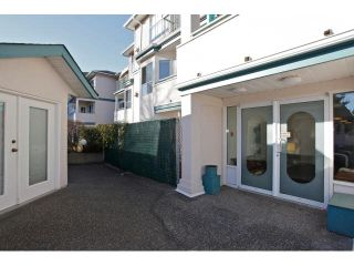 "Photo 2: 311 5955 177B Street in Surrey: Cloverdale BC Condo for sale in ""WINDSOR PLACE"" (Cloverdale)  : MLS®# F1433073"