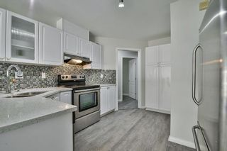 Photo 3: 33 7330 122 Street in Surrey: West Newton Townhouse for sale : MLS®# R2468560