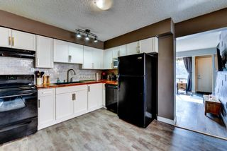 Photo 12: 1 6144 Bowness Road NW in Calgary: Bowness Row/Townhouse for sale : MLS®# A1077373