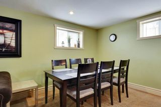 Photo 27: 49 MEADOWVIEW RD SW in Calgary: Meadowlark Park House for sale : MLS®# C4104032