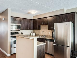 Photo 7: 408 2200 Woodview Drive SW in Calgary: Woodlands Row/Townhouse for sale : MLS®# A1087081