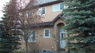 Photo 1: 147 23 Avenue NW in Calgary: Tuxedo Park Row/Townhouse for sale : MLS®# A1047875
