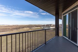 Photo 36: 2407 15 SUNSET Square: Cochrane Apartment for sale : MLS®# A1072593