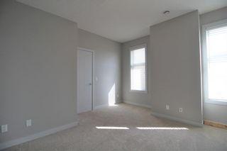 Photo 4: 296 Silverado Plains Park SW in Calgary: Silverado Row/Townhouse for sale : MLS®# A1065666