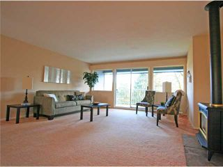 """Photo 1: 1053 CECILE Drive in Port Moody: College Park PM Townhouse for sale in """"CECILE HEIGHTS"""" : MLS®# V931590"""