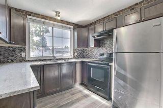 Main Photo: 66 175 Manora Place NE in Calgary: Marlborough Park Row/Townhouse for sale : MLS®# A1121806