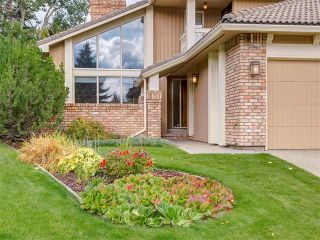 Photo 3: 308 COACH GROVE Place SW in Calgary: Coach Hill House for sale : MLS®# C4064754