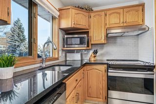 Photo 10: 92 Arbour Glen Close NW in Calgary: Arbour Lake Detached for sale : MLS®# A1066556