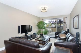 Photo 2: 206 1899 45 Street NW in Calgary: Montgomery Apartment for sale : MLS®# A1095005