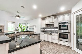 Photo 6: 64 strathlea Place SW in Calgary: Strathcona Park Detached for sale : MLS®# A1117847