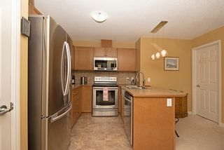 Photo 18: 1202 92 Crystal Shores Road: Okotoks Apartment for sale : MLS®# A1027921