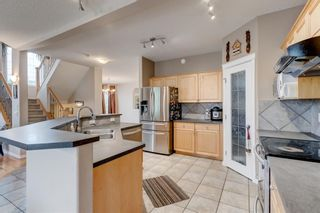 Photo 3: 250 Elmont Bay SW in Calgary: Springbank Hill Detached for sale : MLS®# A1119253