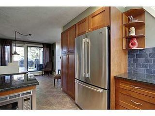 Photo 9: 6 828 COACH BLUFF Crescent SW in Calgary: 2 and Half Storey for sale : MLS®# C3560991