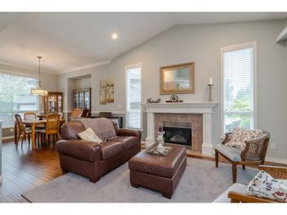 """Photo 3: 18276 69 Avenue in Surrey: Cloverdale BC House for sale in """"Cloverwoods"""" (Cloverdale)  : MLS®# R2369738"""