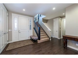 Photo 15: 22 ROCKFORD Road NW in Calgary: Rocky Ridge House for sale : MLS®# C4115282