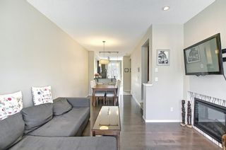 Photo 9: 314 Ascot Circle SW in Calgary: Aspen Woods Row/Townhouse for sale : MLS®# A1111264
