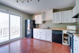 Photo 3: 136 Silvergrove Road NW in Calgary: Silver Springs Semi Detached for sale : MLS®# A1098986