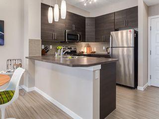 Photo 3: 425 207 SUNSET Drive: Cochrane Apartment for sale : MLS®# C4291361