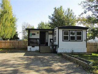 """Photo 1: 8819 75TH Street in Fort St. John: Fort St. John - City SE Manufactured Home for sale in """"ANNEOFIELD"""" (Fort St. John (Zone 60))  : MLS®# N230729"""