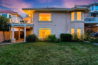 Photo 4: 217 Signature Way SW in Calgary: Signal Hill Detached for sale : MLS®# A1148692