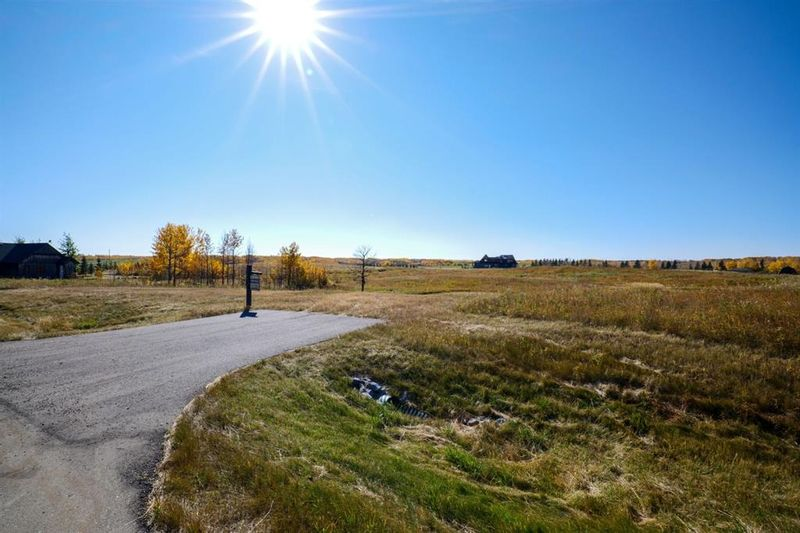 FEATURED LISTING: 61 SILVERHORN Boulevard Rural Rocky View County