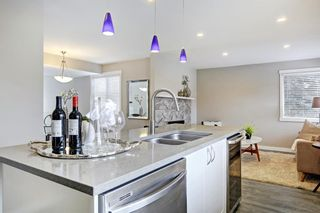 Photo 15: 14 Glamis Gardens SW in Calgary: Glamorgan Row/Townhouse for sale : MLS®# A1076786