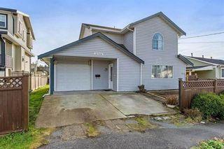 Photo 1: 12706 114A Avenue in Surrey: Bridgeview House for sale (North Surrey)  : MLS®# R2409317