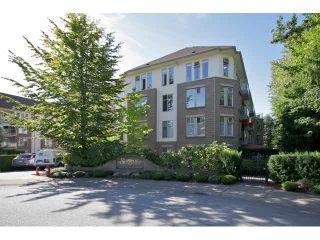 "Photo 1: 401 15340 19A Avenue in Surrey: King George Corridor Condo for sale in ""Stratford Gardens"" (South Surrey White Rock)  : MLS®# F1448318"