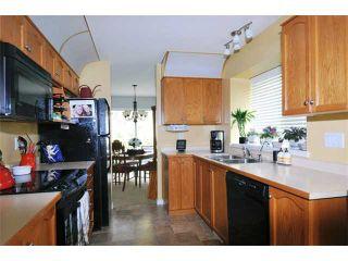 "Photo 2: 37 22740 116TH Avenue in Maple Ridge: East Central Townhouse for sale in ""FRASER GLEN"" : MLS®# V1032832"