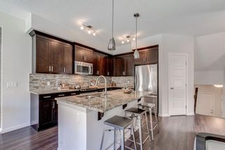 Photo 12: 215 Sunset Point: Cochrane Row/Townhouse for sale : MLS®# A1148057
