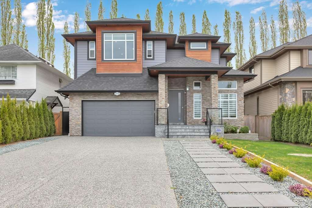 Main Photo: 21650 49A Avenue in Langley: Murrayville House for sale : MLS®# R2587516