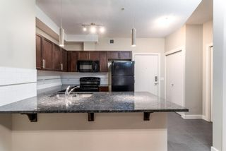 Photo 3: 2129 604 East Lake Boulevard NE: Airdrie Apartment for sale : MLS®# A1106978