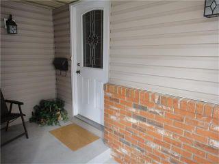 Photo 2: 351 WOODFIELD Road SW in Calgary: Woodbine House for sale : MLS®# C4050173