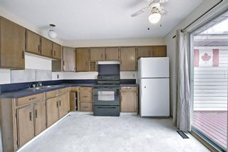 Photo 17: 329 Woodvale Crescent SW in Calgary: Woodlands Semi Detached for sale : MLS®# A1093334