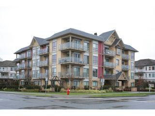 """Photo 1: 108 5811 177B Street in Surrey: Cloverdale BC Condo for sale in """"LATIS"""" (Cloverdale)  : MLS®# R2023487"""