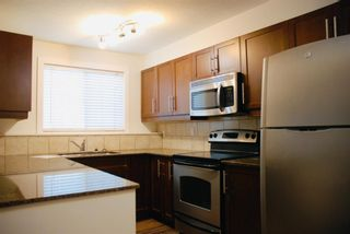 Photo 4: 5 605 67 Avenue SW in Calgary: Kingsland Apartment for sale : MLS®# A1150178