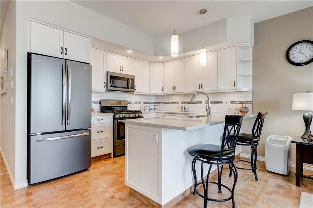 Main Photo: 2002 31 Avenue: Nanton Semi Detached for sale : MLS®# C4222659