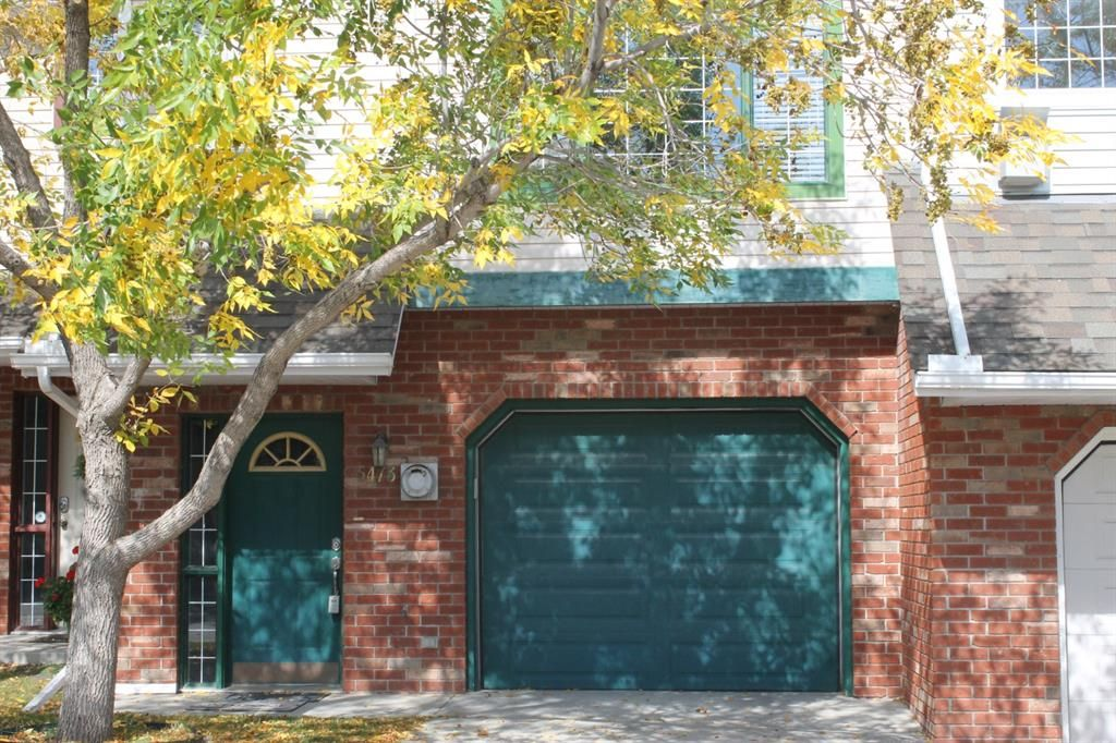 Main Photo: 5473 Patina Drive SW in Calgary: Patterson Row/Townhouse for sale : MLS®# A1147112