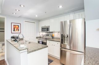 """Photo 3: 311 1288 MARINASIDE Crescent in Vancouver: Yaletown Condo for sale in """"Crestmark I"""" (Vancouver West)  : MLS®# R2602916"""