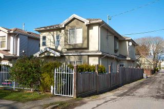 Photo 1: 1869 E 14TH Avenue in Vancouver: Grandview Woodland 1/2 Duplex for sale (Vancouver East)  : MLS®# R2538025