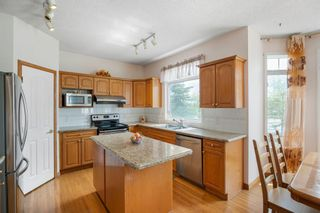 Photo 13: 27 Hampstead Grove NW in Calgary: Hamptons Detached for sale : MLS®# A1113129