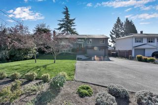 Photo 1: 1611 EASTERN Drive in Port Coquitlam: Mary Hill House for sale : MLS®# R2574066