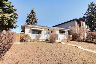 Photo 1: 56 Langton Drive SW in Calgary: North Glenmore Park Detached for sale : MLS®# A1081940