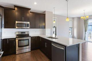 Photo 18: 144 Heritage Boulevard: Cochrane Detached for sale : MLS®# A1125296