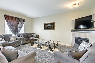 Photo 7: 60 EVERHOLLOW Street SW in Calgary: Evergreen Detached for sale : MLS®# A1118441