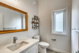Photo 6: 98 23 Street NW in Calgary: West Hillhurst Row/Townhouse for sale : MLS®# A1066637